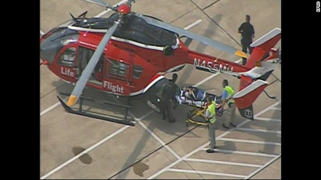 A victim is loaded onto a helicopter.