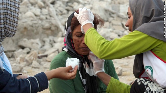 Aid workers give a woman medical treatment in Shanbeh on April 9.