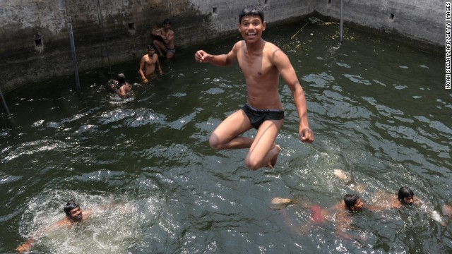 A youth jumps into a water well to cool off in Hyderabad, India, on Wednesday, April 10.