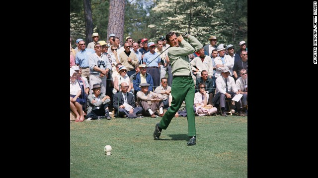 "Doug Sanders, one of golf's earliest flamboyant dressers, tees off on the second hole during the 1966 Masters tournament at Augusta National Golf Club. His knack for lively fabrics earned him the nickname ""Peacock of the Fairways."""