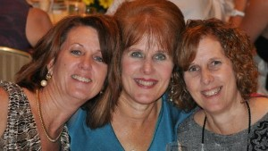 Sisters Mary Scherlach, center, Jane Dougherty, right, and Sue at Mary\'s daughter\'s 2010 wedding.