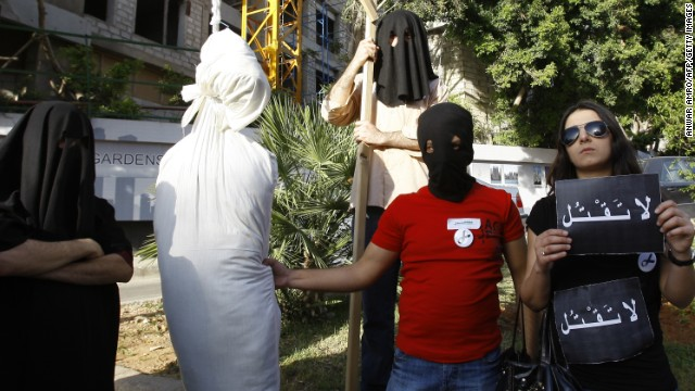 Creating a mock gallows and dummy, human rights activists protest outside the Saudi embassy in Beirut on April 1, 2010.