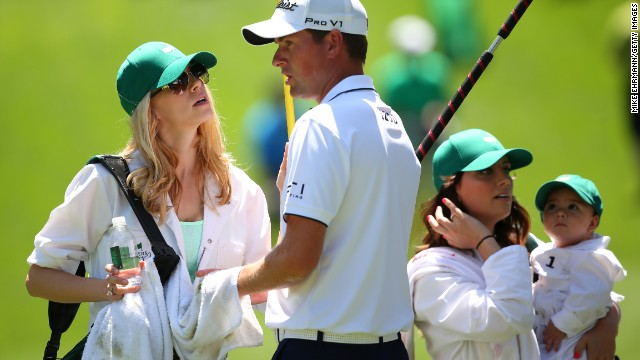 Webb Simpson of the U.S., center, speaks with his wife Dowd Simpson.