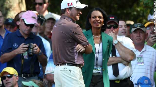 Condoleezza Rice wears the Augusta National Golf Club's members-only green jacket at the start of the Masters on Wednesday.