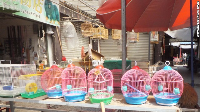 Empty cages are seen at a closed bird market on April 10 in Shanghai.