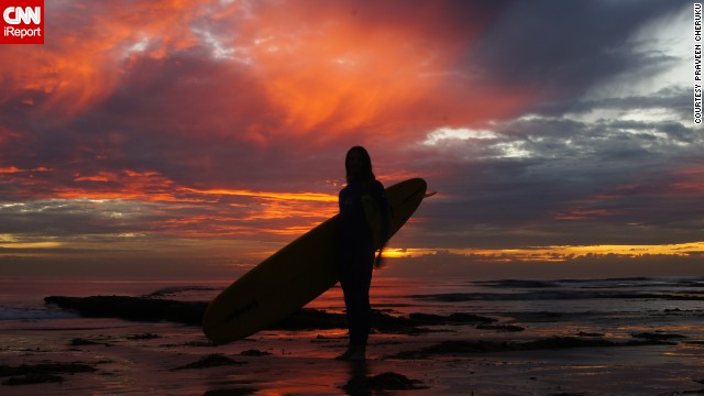 A surfer enjoys the sun on &lt;a href='http://ireport.cnn.com/docs/DOC-883727'&gt;Swami's Beach&lt;/a&gt; before swimming out to sea.