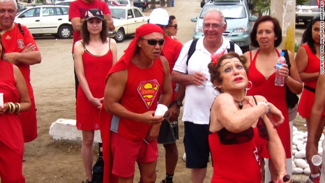 Newcomers are introduced at a Red Dress Run in Peru. The Red Dress charity runs are a hashing tradition.