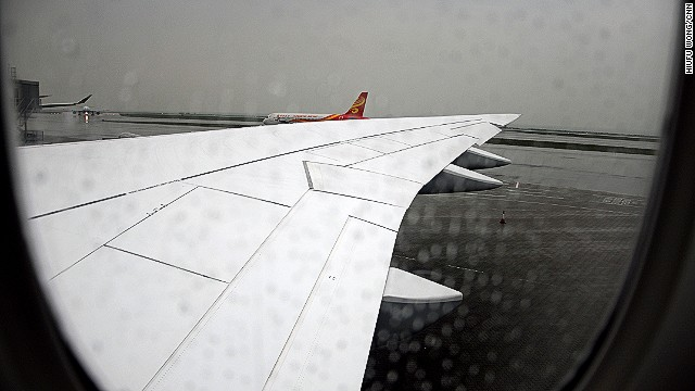 If you didn't notice it in the first two images, this photo taken through a rain-stained window shows the new wing. The Boeing 747-8 has done away with its recognizable winglets. The new raked wingtip design improves aerodynamics, reducing fuel use. The same design is used on the 787 Dreamliner. The 747-8 is 14% more fuel efficient than its predecessor, according to Boeing. Lufthansa says fuel efficiency has been 1% better than forecast. The noise footprint of the plane is about 30% smaller than for the 747-400.