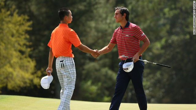 Guan Tianlang of China shakes hands with Matteo Manassero of Italy after the second round of the 2013 Masters Tournament at Augusta National Golf Club on Friday, April 12, in Augusta, Georgia. Click through to see all the shots from the second day and look back at the first round.
