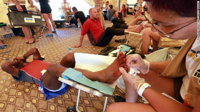 Competitors receive treatment for their feet Thursday during the two-day 75.7 kilometer stage.