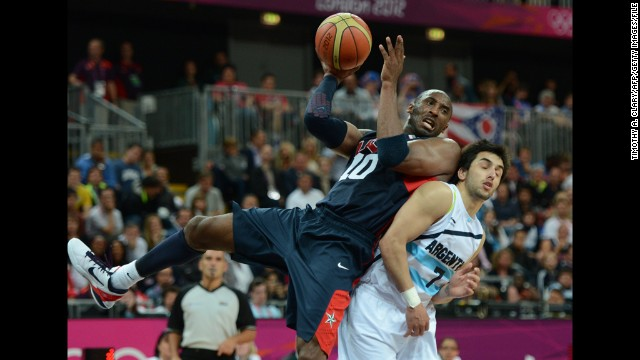 Bryant vies with Argentinian forward Leonardo Gutierrez during the USA men's basketball preliminary round match in the London Olympic Games on August 6, 2012.