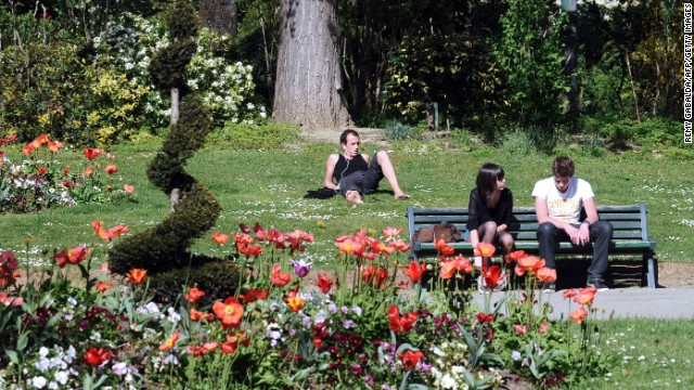 People enjoy the sun in a public garden on Saturday, April 13, in Toulouse, France.