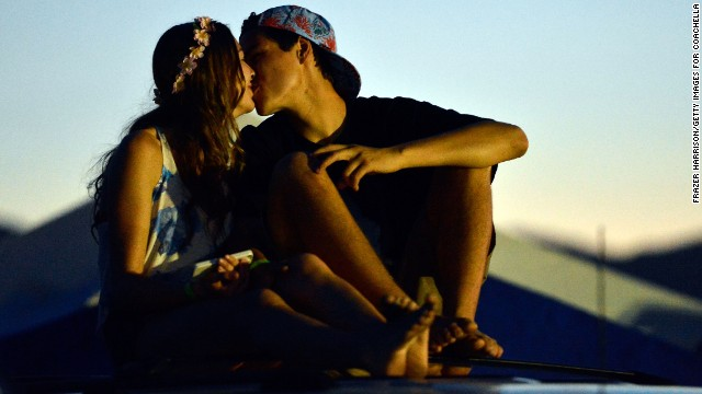 Two festivalgoers kiss at the Empire Polo Field before the 2013 <a href='http://www.coachella.com/index.php' target='_blank'>Coachella Valley Music and Arts Festival</a> in Indio, California, on Thursday, April 11.