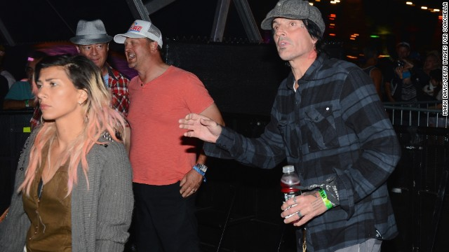 Tommy Lee, right, attends Day One of the festival.