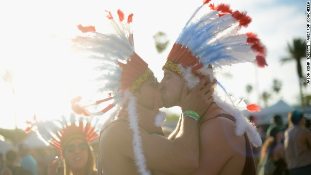 Two men kiss on Day Two of the festival on April 13.