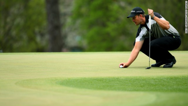 Henrik Stenson of Sweden lines up a putt on the third green during the final round.