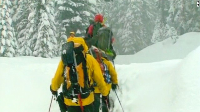 Officials say one person remained missing after two avalanches hit two separate groups near Snoqualmie Summit.