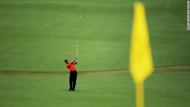 Tiger Woods of the U.S. hits a shot on the second hole.