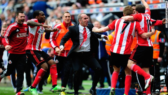 Di Canio celebrates with his Sunderland players during their crucial victory. Sunderland is now three points clear of the relegation zone with five games remaining.