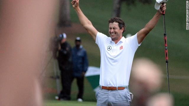 Adam Scott celebrates after he makes a birdie putt on the second sudden-death playoff hole.