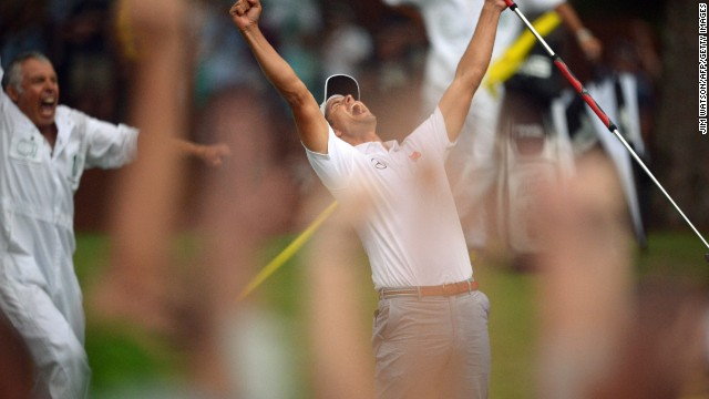 Adam Scott celebrates his win on the 10th hole.