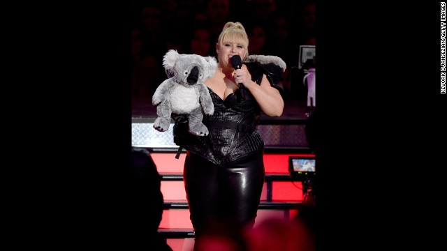 "Host Rebel Wilson, who hails from Australia, injects some Down Under flavor into Sunday's proceedings. <a href='http://www.mtv.com/videos/misc/898751/rebel-wilson-and-her-koala-chlamydia-scope-out-the-crowd.jhtml' target='_blank'>She brings out a stuffed koala</a> and uses its ""excellent X-ray vision"" to play pranks on celebrities Quvenzhané Wallis and Chris Evans."