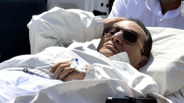 Ousted Egyptian president Hosni Mubarak is wheeled out of an ambulance following a hearing in Cairo on April 13, 2013.