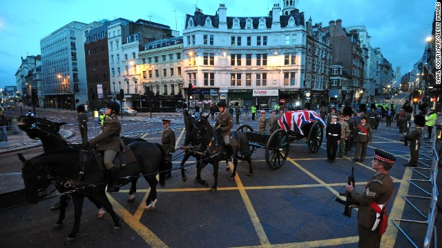 A Gun Carriage of the King's Troop Royal Horse Artillery carrying a coffin passes through Ludgate Circus.