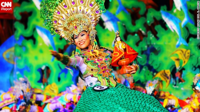 A performer wears a brightly colored costume at the 2013 Sinulog Festival, which celebrates the Philippines' religious history. See more photos on <a href='http://ireport.cnn.com/docs/DOC-919869'>CNN iReport</a>.