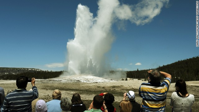 Old Faithful Geyser, pictured, and Upper Geyser Basin at Yellowstone National Park in Wyoming give visitors an impressive natural show. Old Faithful spews a jet of boiling water into the air approximately every 90 minutes.