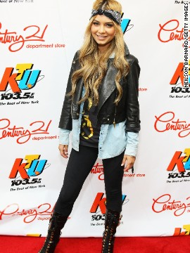 Leggings are a great layering piece. Singer Havana Brown's outfit works equally well with the jacket open or zipped thanks to her long tee.