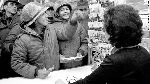 Argentine soldiers buy postcards at a souvenir shop in Stanley after they invaded the Falkland Islands in April 1982.