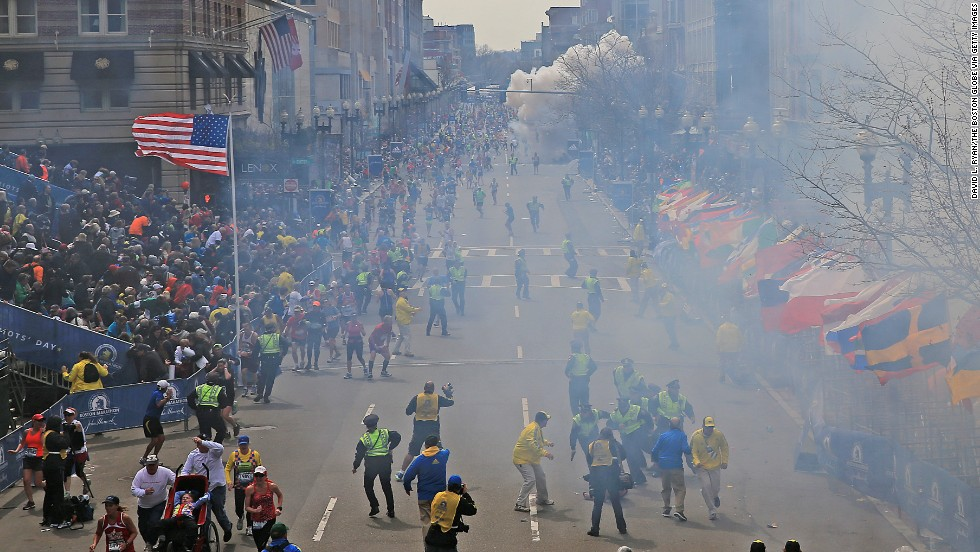 Bombings at the Boston Marathon on Monday, April 15, followed by a manhunt kept the Boston area reeling until the surviving suspect was captured on Friday, April 19. Pictured, the second explosion goes off near the marathon finish line on Monday while smoke from the first bomb still hangs in the air. Here's a look at how the week unfolded: