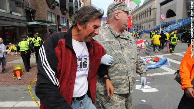 A man in tears is helped at the scene on Boylston Street in Boston.