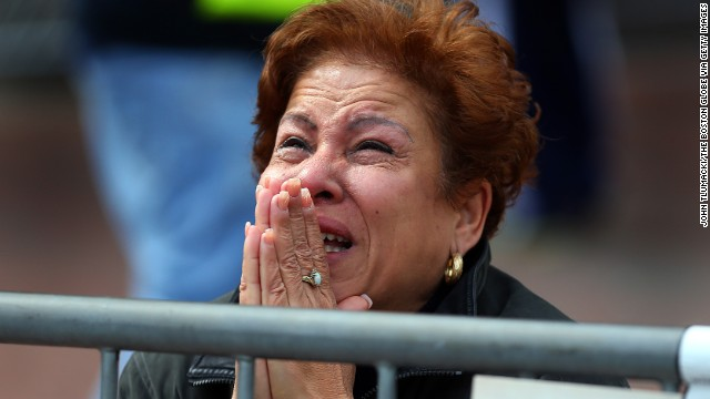 A woman kneels and prays at the scene of two apparent bombings near the finish line of the Boston Marathon on Monday, April 15. <a href='http://www.cnn.com/2013/04/15/us/boston-marathon-explosions/index.html'>Read our developing news story</a> and follow up-to-the-minute reports <a href='http://news.blogs.cnn.com/2013/04/15/explosions-near-finish-of-boston-marathon/'>on CNN.com's This Just In blog</a>.