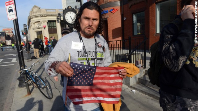 Carlos Arredondo, who was near the finish line when the bombs detonated, leaves the scene. He was at the race handing out American flags to spectators. After the blasts, he helped emergency responders and is credited with helping a man with serious leg wounds survive.