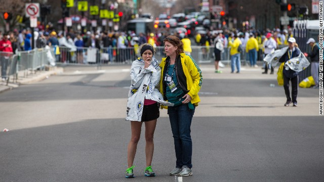 A runner is comforted following the attack.