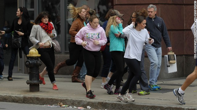 People run down Exeter Street after the blasts.