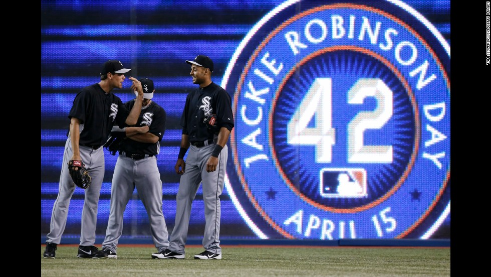 """Matt Thornton, left, and Alex Rios of the Chicago White Sox wait in the outfield during batting practice before the start of the game against the Toronto Blue Jays at Rogers Centre on Monday, April 15, in Toronto, Ontario, Canada. All baseball players wore jerseys with No. 42 in honor of <a href='http://inamerica.blogs.cnn.com/2013/04/15/opinion-its-jackie-robinson-day-but-black-boys-no-longer-dream-of-playing-baseball/'>Jackie Robinson Day</a>. The Brooklyn Dodgers great, whose story is told in the new movie <a href='http://www.cnn.com/2013/04/02/showbiz/movies/jackie-robinson-movie-42/index.html'>""""42,""""</a> was the first African-American to play Major League Baseball in the modern era. Robinson broke the color barrier on April 15, 1947."""