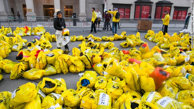 Unclaimed runners' bags fill an area near the marathon finish.