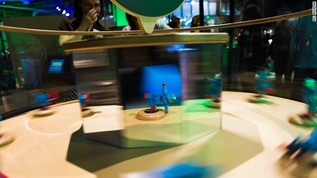 A spinning exhibit turns still figures into moving ones.