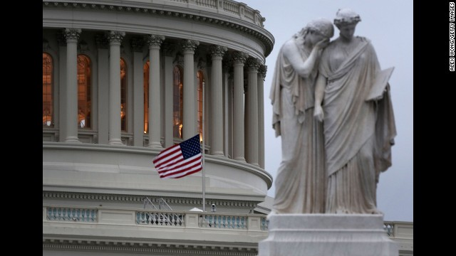 A U.S. flag flies at half staff at the Capitol on Monday after House Speaker John Boehner ordered flags to be lowered.