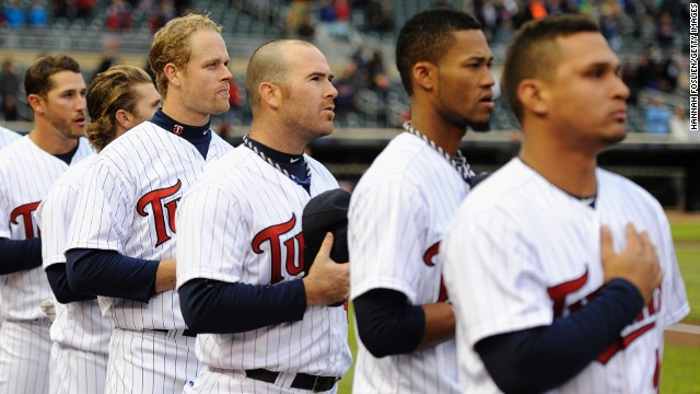 The Minnesota Twins stand during the national anthem before their game on Monday, April 15, in Minneapolis, following a moment of silence to honor the victims of the Boston Marathon bombings.