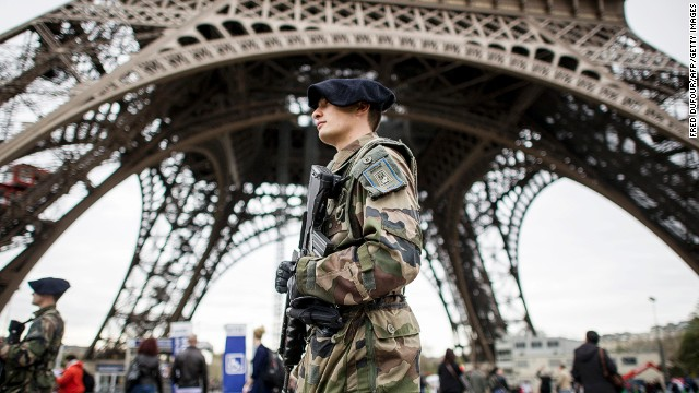 French soldiers patrol the Eiffel Tower in Paris on April 16. Security in public areas and events was stepped up after the bombings.