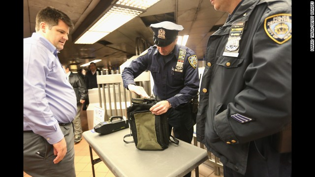 A New York police officer inspects a man's bag in Grand Central Terminal in Manhattan on Monday.
