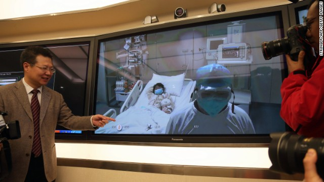 Cheng Jun, vice president of Beijing's Ditan hospital, shows a video of the first bird flu victim in intensive care during a press conference on Saturday, April 13.