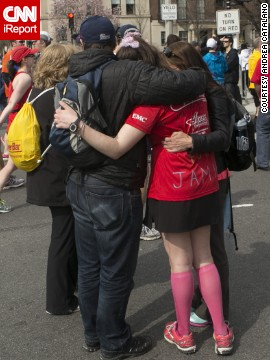 <a href='http://ireport.cnn.com/docs/DOC-957434'>Andrea Catalano</a>, a freelance photographer, shot this photo about a mile from the Boston Marathon finish line. He wanted to capture the outpouring of support from spectators and people in the area, comforting and assisting runners.