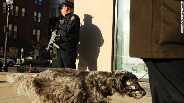A Boston police officer is heavily armed blocks away from the scene of the bombings.