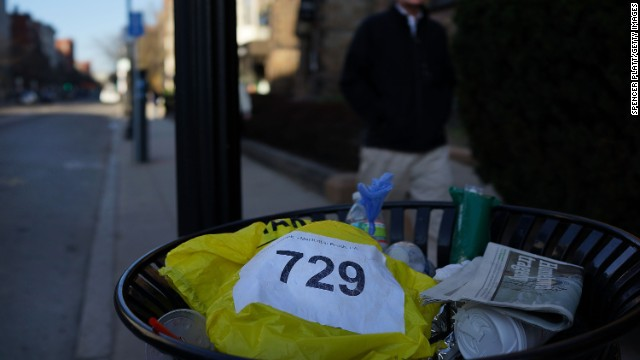 A runners bib lies discarded April 16. <a href='http://www.cnn.com/SPECIALS/us/boston-bombings-galleries/index.html'>See all photography related to the Boston bombings.</a>v