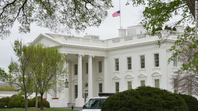 The flag above the White House flies at half staff on Tuesday, April 16 in Washington.